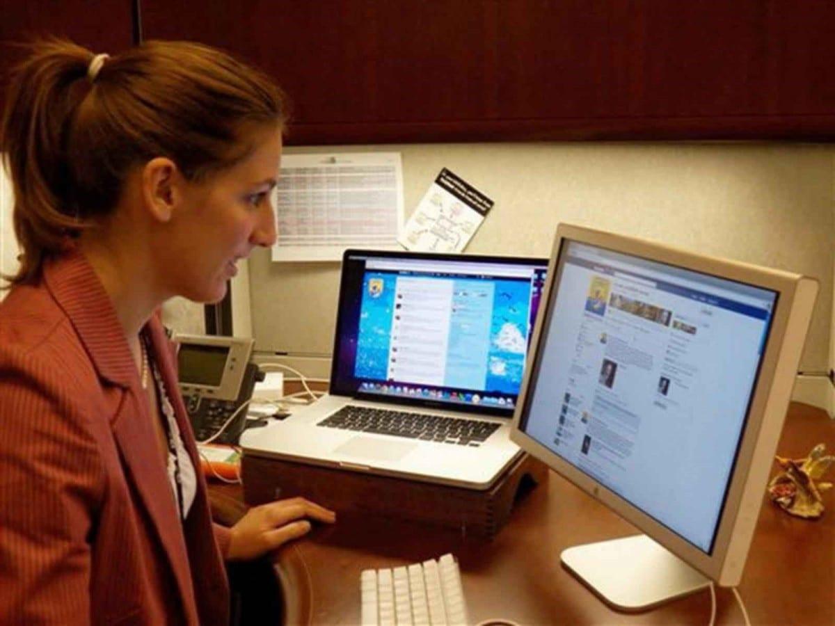 an employee checks on social media at work