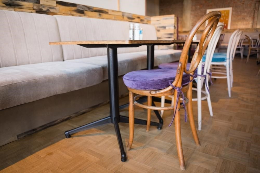 Coffee Shop with a table and purple chair.