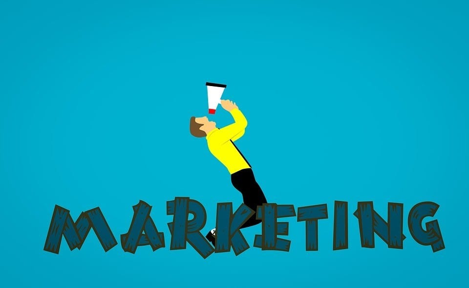 man shouting marketing in a megaphone
