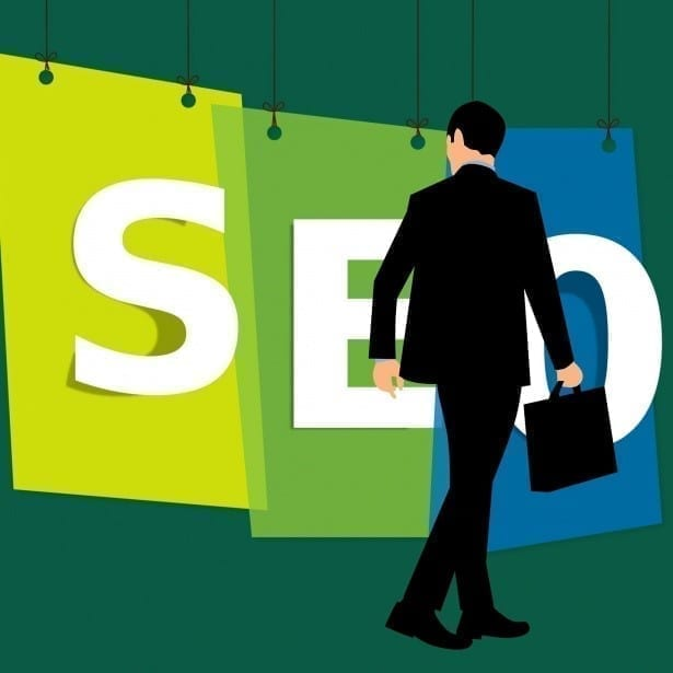 Man with a briefcase looking at SEO.